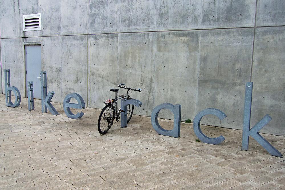 A bike left on a rack.