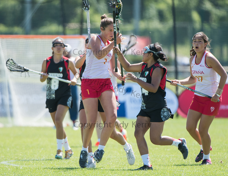Spain's Marina Burke(1) evades the challenge of Mexico's Alejandra Pérez at the 2017 FIL Rathbones Women's Lacrosse World Cup at Surrey Sports Park, Guilford, Surrey, UK, 15th July 2017