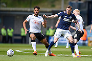 Craig Forsyth and Martyn Woolford battle for the ball during the Sky Bet Championship match between Millwall and Derby County at The Den, London, England on 25 April 2015. Photo by David Charbit.