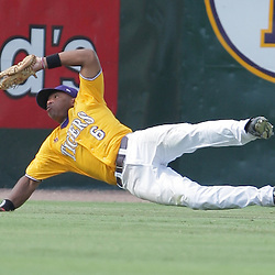 Leon Landry #6 of LSU dives to make a catch to end the sixth inning for UC Irvine. The LSU Tigers defeated the UC Irvine Anteaters 9-7 with a ninth inning rally in game two of a three game NCAA Baseball Super Regional playoff at Alex Box Stadium in Baton Rouge, LA..
