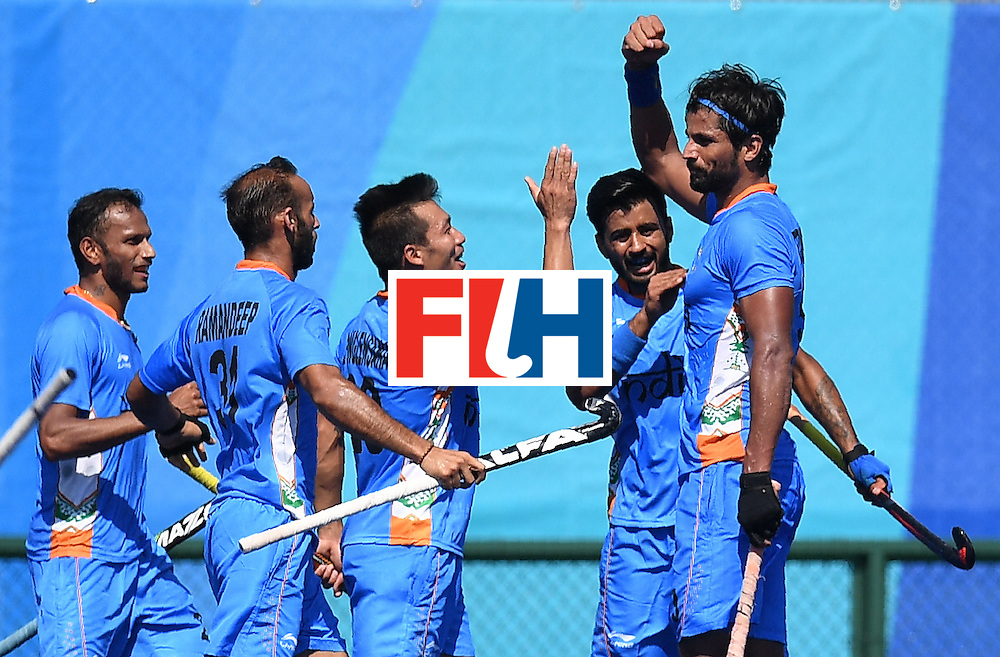 India's Rupinder Pal Singh (R) celebrates scoring a goal during the men's field hockey India vs Ireland match of the Rio 2016 Olympics Games at the Olympic Hockey Centre in Rio de Janeiro on August, 6 2016. / AFP / MANAN VATSYAYANA        (Photo credit should read MANAN VATSYAYANA/AFP/Getty Images)