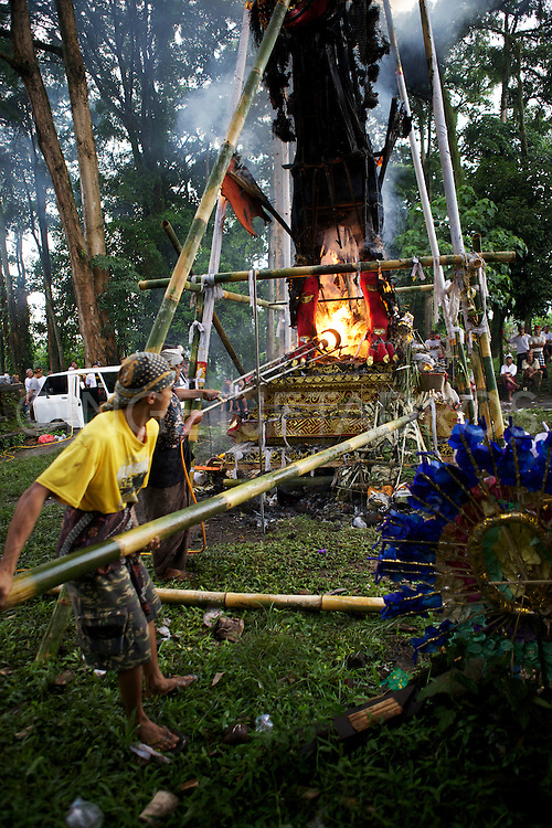 Men attending the fire during a cremation ceremony.<br />