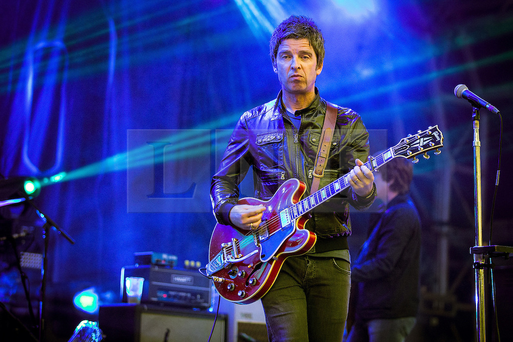 © Licensed to London News Pictures . 11/07/2015 . Manchester , UK . Noel Gallagher's High Flying Birds perform . Summer in the City , live music as part of the Manchester International Festival , at the Castlefield Arena in Manchester . Limited to use for 60 days from event date . Photo credit : Joel Goodman/LNP