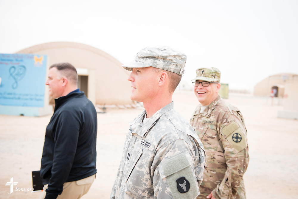 Army Capt. Chad Czischke, chaplain, walks with the Rev. Craig G. Muehler, director of the LCMS Ministry to the Armed Forces (left), and Army Lt. Col Steven Hokana, during a visit Sunday, March 22, 2015, at Camp Buehring in Kuwait. LCMS Communications/Erik M. Lunsford