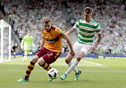 Celtic's Mikael Lustig (right) competes with Motherwell's Chris Cadden during the William Hill Scottish Cup Final at Hampden Park, Glasgow.