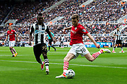 Barnsley defender Adam Jackson (#18) clears the ball during the EFL Sky Bet Championship match between Newcastle United and Barnsley at St. James's Park, Newcastle, England on 7 May 2017. Photo by Craig Doyle.