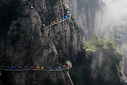 LUOYANG, CHINA - JULY 16: <br /> <br /> Tents are set up on a 1,000-meter-high plank road at Laojun Mountain on July 16, 2016 in Luoyang, Henan Province of China. Visitors arrived at Laojun Mountain on Friday night and then pitched tents on plank road to welcome a camp festival the following day.<br /> ©Exclusivepix Media