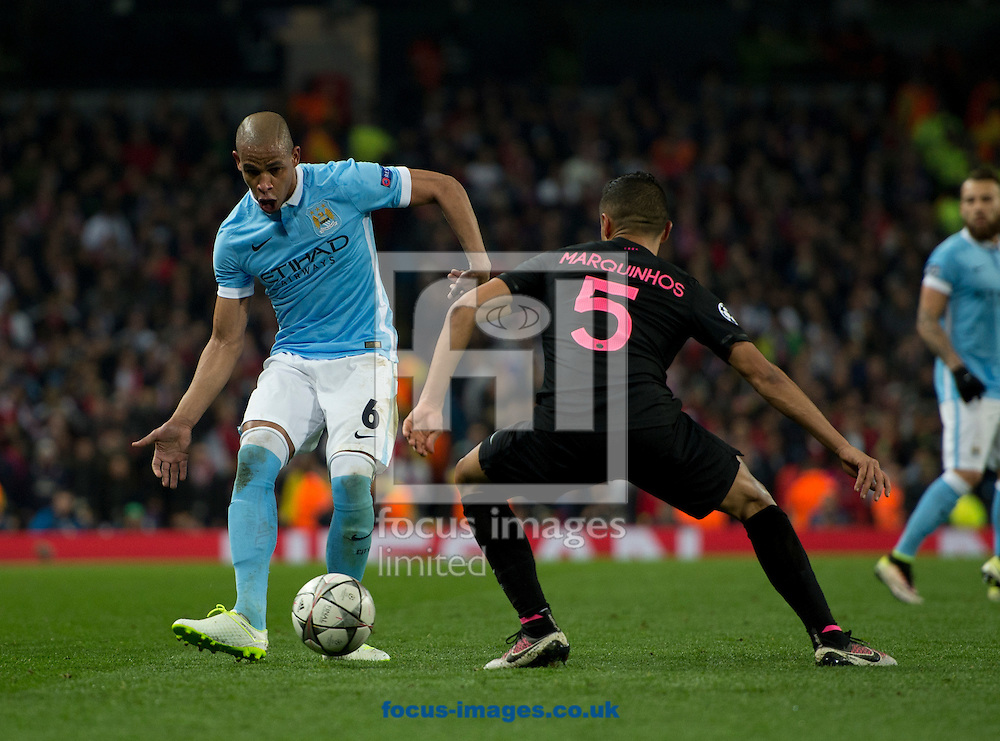Fernando of Manchester City (left) looks to play the ball past Marquinhos of Paris Saint-Germain during the UEFA Champions League match at the Etihad Stadium, Manchester<br /> Picture by Russell Hart/Focus Images Ltd 07791 688 420<br /> 12/04/2016