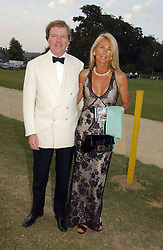 The HON.CHARLES & MRS PEARSON at the Cowdray Gold Cup Golden Jubilee Ball held at Cowdray Park Polo Club, on 21st July 2006.<br />