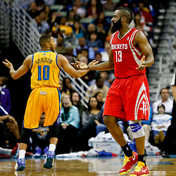 Jan 25, 2013; New Orleans, LA, USA; Houston Rockets shooting guard James Harden (13) and New Orleans Hornets shooting guard Eric Gordon (10) react to a foul call during the second quarter of a game at the New Orleans Arena. Mandatory Credit: Derick E. Hingle-USA TODAY Sports