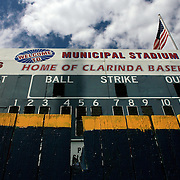 The Municipal Stadium scoreboard towers over the left field fence.  photo by David Peterson