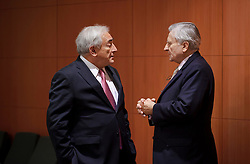 Dominique Strauss-Kahn, managing director of the IMF, left, speaks privately with Jean-Claude Trichet, president of the European Central Bank, during a meeting of the Euro-zone finance ministers at the EU Council headquarters in Brussels, Monday, Dec. 6, 2010.  (Photo © Jock Fistick)