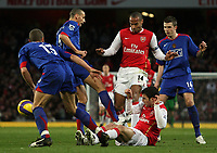 Photo: Paul Thomas.<br /> Arsenal v Manchester United. The Barclays Premiership. 21/01/2007.<br /> <br /> Arsenal's Thierry Henry (14) runs into traffic and his own team-mate Cesc Fabregas (Ground).