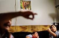 NEW ORLEANS, LA- June 22:  (L-R)  Dung Nguyen talks to family, Ut and lisa Nguyen, about a cancelled shrimp boat job.... The Nguyens', a Vietnamese fishing family, at home in east New Orleans, New Orleans, Louisiana, Tuesday June 22, 2010.  Dung Nguyen, the father, has been unable to work on the shrimp boat since the spill, and has had to apply for assistance and train for oil spill clean up work. (Melina Mara/The Washington Post)