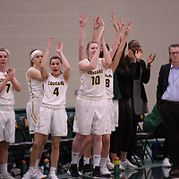 The bench celebrates during the Women's Basketball home game on January  19 at Centre for Kinesiology, Health and Sport. Credit: Arthur Ward/Arthur Images