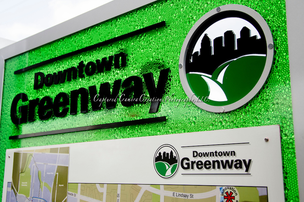 Greensboro Greenway walking path entry way monument feature local art work representing the local area, Monday May, 20 2013.   (Wesley Brown/3cPhoto)