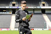 Forest Green Rovers Liam Shephard(2) reads the match day programme during the EFL Sky Bet League 2 match between Milton Keynes Dons and Forest Green Rovers at stadium:mk, Milton Keynes, England on 15 September 2018.