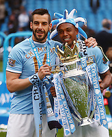 Alvaro Negredo and Fernandinho of Manchester City with the Barclays Premier League trophy