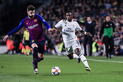 February 6, 2019 - Barcelona, Spain - 03 Gerard Pique of FC Barcelona and 28 Vinicius of Real Madrid during the semi-final first leg of Spanish King Cup / Copa del Rey football match between FC Barcelona and Real Madrid on 04 of February of 2019 at Camp Nou stadium in Barcelona, Spain  (Credit Image: © Xavier Bonilla/NurPhoto via ZUMA Press)
