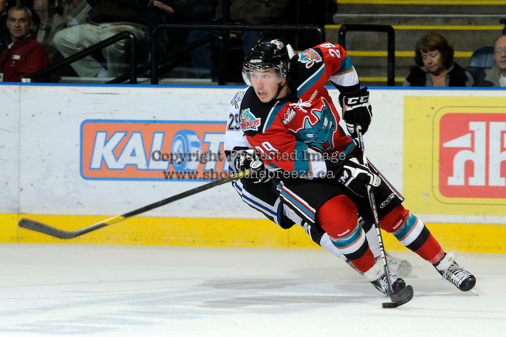 KELOWNA, CANADA, OCTOBER 22: Myles Bell #29 of the Kelowna Rockets skates with the puck as the Victoria Royals visited the Kelowna Rockets on October 22, 2011 at Prospera Place in Kelowna, British Columbia, Canada (Photo by Marissa Baecker/shootthebreeze.ca) *** Local Caption ***Myles Bell;