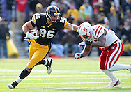 November 23 2012: Iowa Hawkeyes tight end C.J. Fiedorowicz (86) stiff arms Nebraska Cornhuskers linebacker Alonzo Whaley (45) after a reception during the first half of the NCAA football game between the Nebraska Cornhuskers and the Iowa Hawkeyes at Kinnick Stadium in Iowa City, Iowa on Friday November 23, 2012. Nebraska defeated Iowa 13-7 in the Heroes Game on Black Friday.