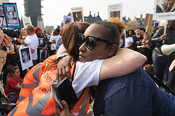 © Licensed to London News Pictures. 17/04/2019. London, UK. Two women share a hug as bereaved relatives and campaigners occupy Westminster Bridge during a protest to demand government action on knife crime. Photo credit: Rob Pinney/LNP