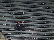 October 11, 2017 - Cleveland, OH, USA - Cleveland Indians fans sit alone in the left field bleachers after the New York Yankees won, 5-2, in Game 5 of the American League Division Series, Wenesday, Oct. 11, 2017, at Progressive Field in Cleveland. The Yankees advanced to meet the Houston Astros in the A.L. Championship Series. (Credit Image: © Phil Masturzo/TNS via ZUMA Wire)