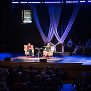 NHPR's Virginia Prescott interviews chef Mario Batali during a Writers on a New England Stage show at The Music Hall in Portsmouth, NH