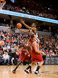 Virginia guard Sean Singletary (44) is fouled by North Carolina State forward/center Ben McCauley (34) while going up for a shot.  The Virginia Cavaliers men's basketball team defeated the North Carolina State Wolfpack 78-60 at the John Paul Jones Arena in Charlottesville, VA on February 24, 2008.