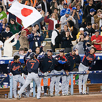 23 March 2009: #7 Yasuyuki Kataoka of Japan celebrates with teammates after scoring during the 2009 World Baseball Classic final game at Dodger Stadium in Los Angeles, California, USA. Japan defeated Korea 5-3
