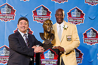 07 August 2010: Former San Francisco 49ers wide receiver Jerry Rice and former 49ers owner Eddie Debartolo stand with the Jerry Rice bust at the enshrinement ceremony at the Pro Football Hall of Fame in Canton, Ohio.