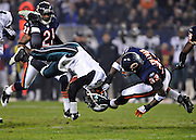 Chicago Bears cornerback Charles Tillman brings down Philadelphia Eagles quarterback Michael Vick in the Eagles' 24-20 win over the Bears at Solider Field in Chicago, Ill.