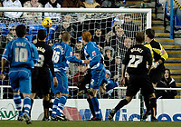 Photo: Daniel Hambury.<br />Reading v Luton Town. Coca Cola Championship.<br />03/12/2005.<br />Reading's Dave Kitson (centre) watches as his header beats Luton keeper Marlon Beresford to score the second goal.