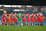 Macclesfield Town players with a minute silence during the The FA Cup match between Portsmouth and Macclesfield Town at Fratton Park, Portsmouth, England on 7 November 2015. Photo by Adam Rivers.