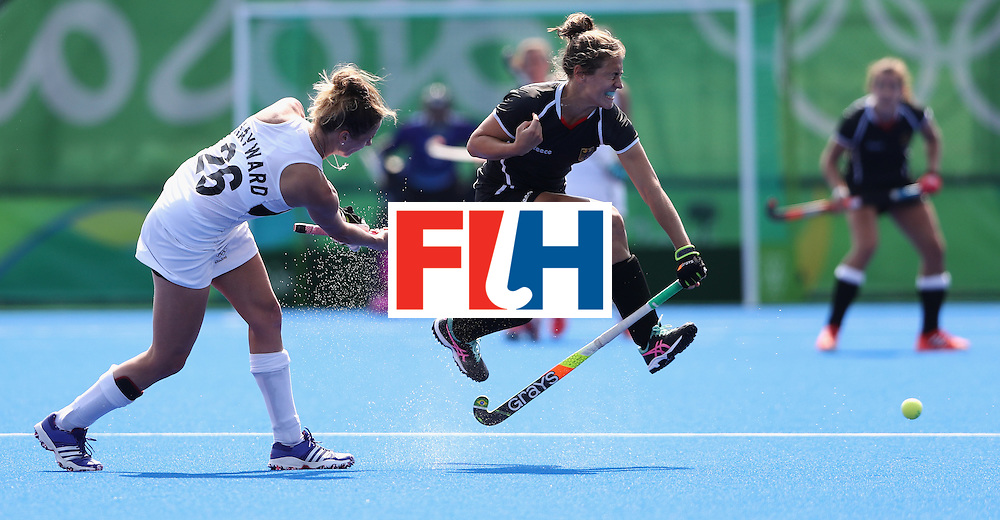 RIO DE JANEIRO, BRAZIL - AUGUST 19:  Pippa Hayward (L) of New Zealand plays the ball past Marie Mavers during the Bronze medal match between Germany and New Zealand on Day 14 of the Rio 2016 Olympic Games held at the Olympic Hockey Centre on August 19, 2016 in Rio de Janeiro, Brazil.  (Photo by David Rogers/Getty Images)