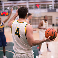 5th year guard Alex Igual (4) of the Regina Cougars in action during the Men's Basketball home game on January  19 at Centre for Kinesiology, Health and Sport. Credit: Arthur Ward/Arthur Images