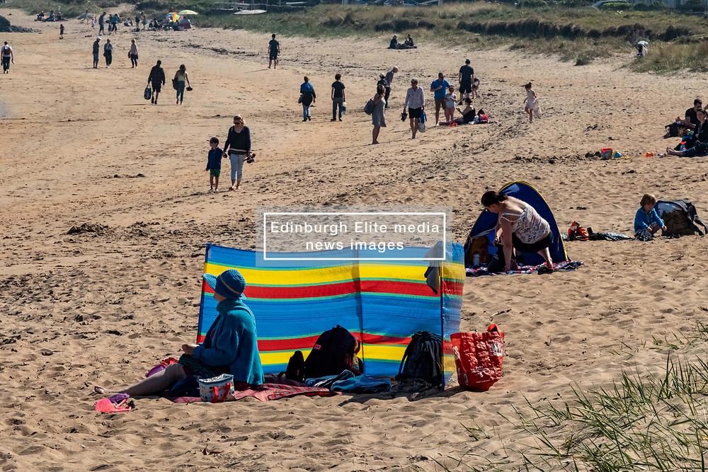 Pictured: <br /> Visitors to North Berwick enjoyed an old fashioned beach break with kids, dogs, adlults hiding behind windbreaks and temperatures of 23 degrees. Views of the Bass Rock, which houses the largest gannet population in the world, enhanced the old tyme feeling.<br /> <br /> <br /> Ger Harley | EEm 22 April 2019