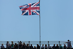 © Licensed to London News Pictures. 23/07/2016. Southsea, United Kingdom.  Spectators in the grand stand watching the first day of racing for the America's Cup World Series (ACWS) in Portsmouth this weekend, 22nd-24th July 2016. British Olympic sailing legend, Sir Ben Ainslie, is leading his all-British team, Land Rover BAR, against other teams in a battle to qualify for a place in the two team America's Cup final, to be held in Bermuda in 2017. Photo credit: Rob Arnold/LNP