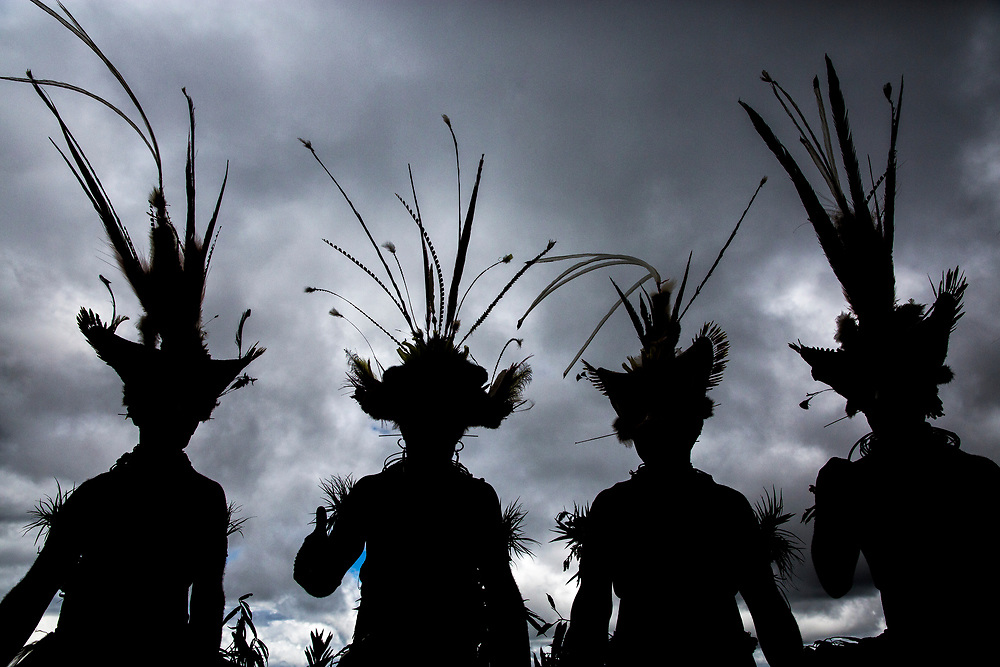 Silhouette of Huli wigmen in the Southern Higlands of Papua New Guinea.