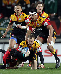 Chiefs' Robbie Robinson is tackled by Crusaders' Matt Todd in the semi-final Super Rugby match, Waikato Stadium, Hamilton, New Zealand, Friday, July 27, 2012.  Credit:SNPA / David Rowland