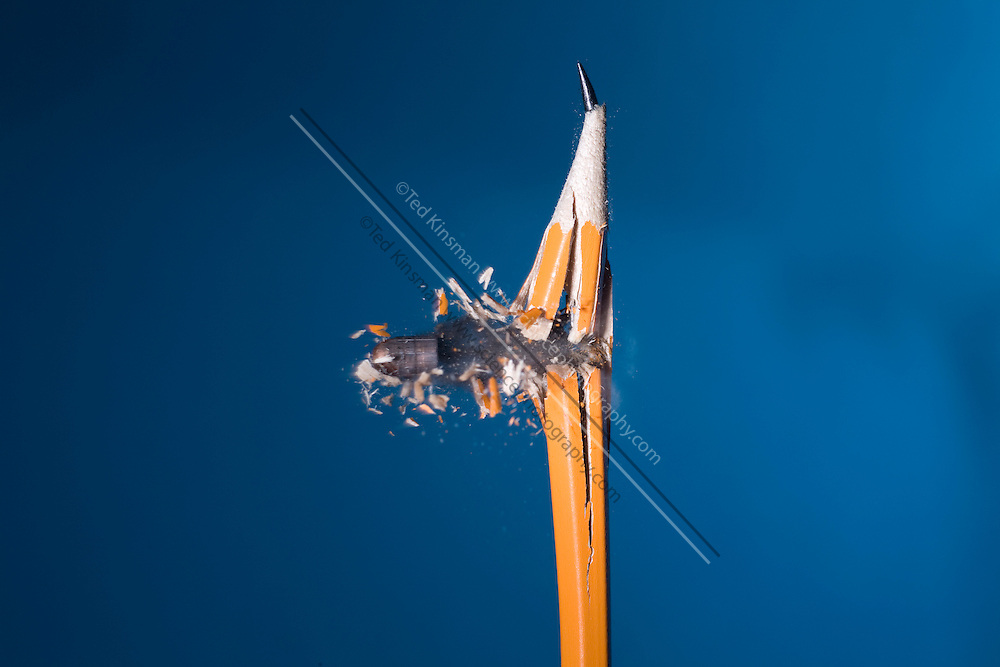 A .22 caliber bullet hitting a pencil.  The bullet is traveling at 660 feet per second (201.2 meters per second). This image shows the collision of the bullet and pencil photographed at  1/1,000,000th of a second.