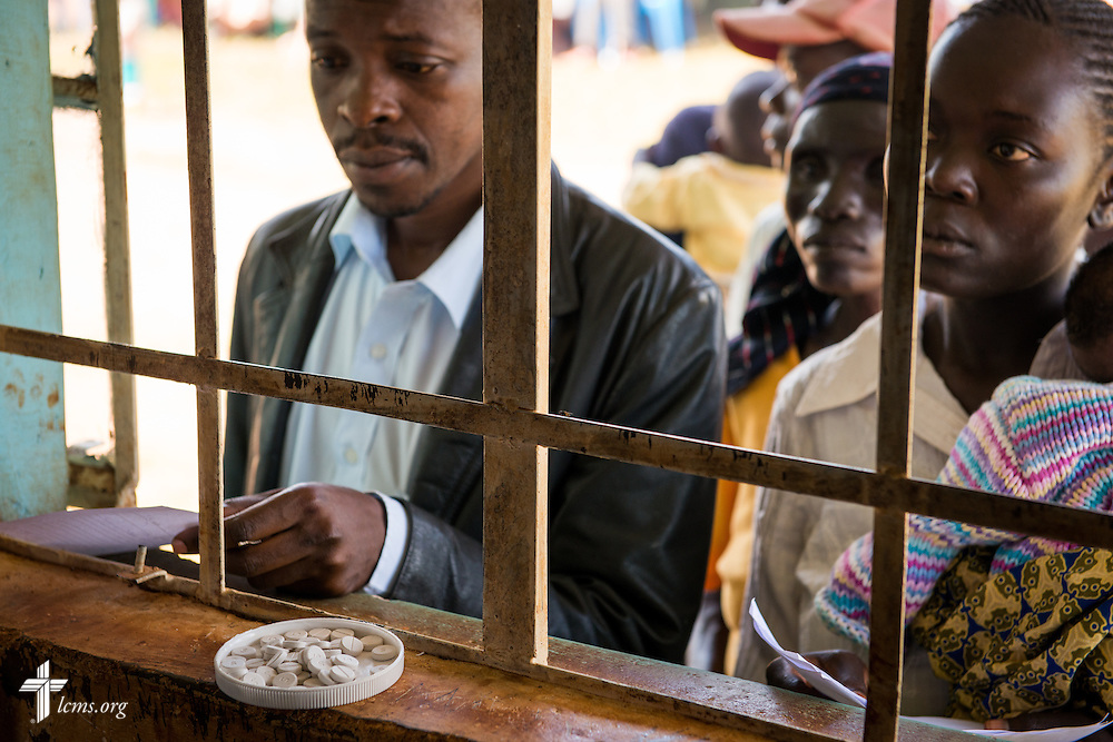 Patients queue at the pharmacy window during the Mercy Medical Team clinic Thursday, June 12, 2014, at the Luanda Doho Primary School in Yala, Kenya. LCMS Communications/Erik M. Lunsford