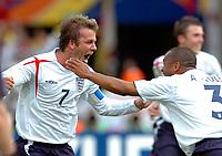 Photo: WROFOTO/Sportsbeat Images.<br />England v Ecuador. 2nd Round, FIFA World Cup 2006. 25/06/2006. <br />England's David Beckham celebrates his goal with Ashley Cole.