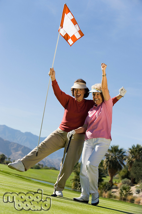 Excited Women on Putting Green