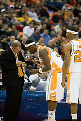 Tennessee Volunteers forward Duke Crews (32) replaces a lost contact during a game against Long Beach State.  The #5 seed Tennessee Volunteers defeated the #12 seed Long Beach State 49ers 121-86  in the first round of the Men's NCAA Tournament in Columbus, OH on March 16, 2007.
