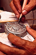 A fourth-generation silversmith, Bozgigitov Bakit, painstakingly restores a pectoral ornament for the local museum in his studio at Aktau in the Manghstau region of southerwestern Kazakhstan.