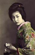 Memories of a geisha: Stunning images reveal the delicate beauty of the woman who enchanted Tokyo 100 years ago<br /> <br /> <br /> The beauty of one of Tokyo's most popular geisha has been preserved in a series of stunning postcards taken more than a century ago. <br /> The collection of images shows Hawaryu, who worked in the Japanese capital at the beginning of the 20th century, posing in a variety of elaborate kimono with her hair pinned in traditional style. <br /> Her porcelain skin and doll-like features have captured the imagination of internet users who have shared the pictures hundreds of times since they were posted. <br /> They were unearthed by an American photographer who lives and works in Japan and posted on his Flickr account under the name Okinawa Soba. <br /> He said the selection were taken in 1910, only a few years before the number of geisha working in the country reached its peak.<br /> It is not known how old Hawaryu is in the series of pictures but her hairstyle suggests she was an apprentice geisha - or maiko - and therefore was probably under 20 years old. <br /> Geisha as a profession emerged in the 18th century and rather than courtesans, women would entertain act as hostesses and entertain male guests with their demure conversation and graceful dance and music skills. <br /> Not much is known about Harwaryu other than the pictures she left behind. <br /> If her marriage was delayed or did not take place then she may have continued working as a geisha for years. <br /> More is known about the photographers, whose initials were left on the images. <br /> One photographer is believed to be Shisui Naruse and the other is thought to be Yoto Tsukamoto. <br /> Okinawa Soba said of the Naruse: 'He obviously considered his portraits to be artistic works, and proudly put his intertwined S N monogram right on the negative.'<br /> The images were printed on mass using the collotype process and the coloured detail would have been hand-painted afterwards. <br /> In some of the images crosshatching can also be seen on the hairline and eyebrows,