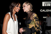 JOAN SMALES; NATASHA POLL,  ; , The Global launch of the 2012 Pirelli Calendar by Mario Sorrenti.  Dinner at the Park Avenue Armory. Manhattan. 6 December 2011.