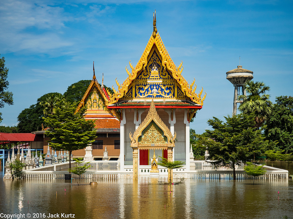 30 SEPTEMBER 2016 - SAI NOI, AYUTTHAYA, THAILAND: A prayer hall at the flooded Wat Sai Noi in Sai Noi. The Chao Phraya River, the largest river that runs through central Thailand, has hit flood stage in several areas in Ayutthaya and Ang Thong provinces. Villages along the river are flooded and farms are losing their crops due to the flood. This is the same area that was devastated by floods in 2011, but the floods this year are not expected to be as severe. The floods are being fed by water released from upstream dams. The water is being released to make room for heavy rains expected in October.      PHOTO BY JACK KURTZ