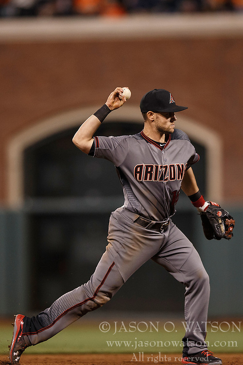 SAN FRANCISCO, CA - APRIL 18: Chris Owings #16 of the Arizona Diamondbacks throws to first base against the San Francisco Giants during the sixth inning at AT&T Park on April 18, 2016 in San Francisco, California. The Arizona Diamondbacks defeated the San Francisco Giants 9-7 in 11 innings.  (Photo by Jason O. Watson/Getty Images) *** Local Caption *** Chris Owings